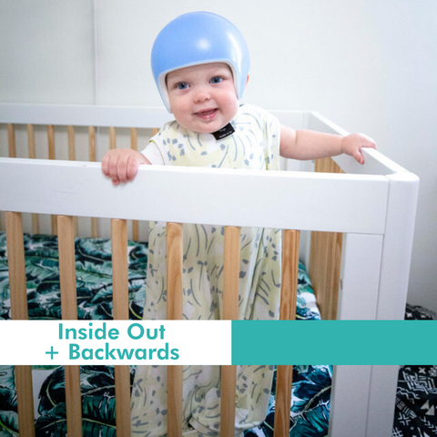baby with sleep sack on inside out and backwards