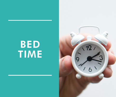 little white clock held in hand, with header 'bed time'