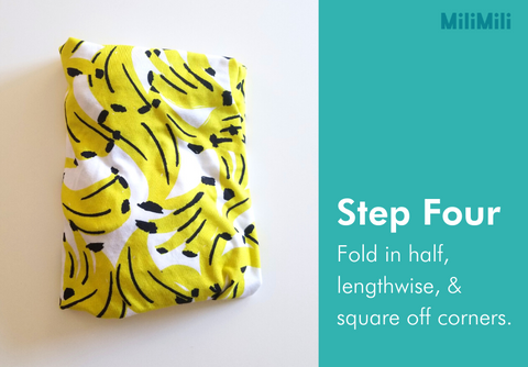 How to fold a crib sheet: step four - fold sheet in half, lengthwise, and square off the corners. Banana print cribsheet from MiliMili.
