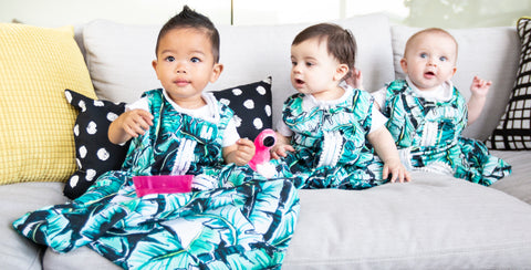 babies on couch all wearing milimili palm print sleep sacks