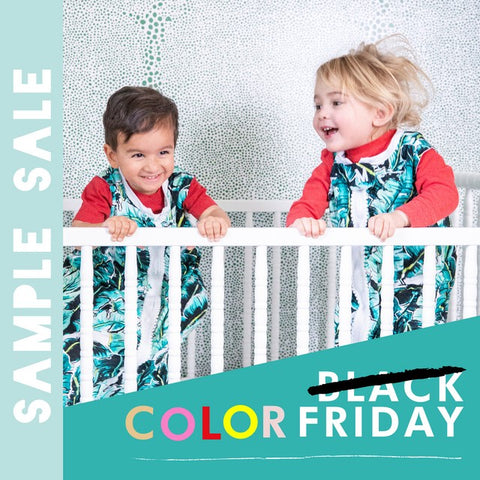 Sleep Sack sample sale for Black Friday - newly renamed Color Friday. Image shows two toddlers in red PJs and palm print sleep sacks jumping in a crib.