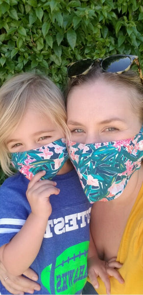 mom and toddler wearing matching colorful face masks