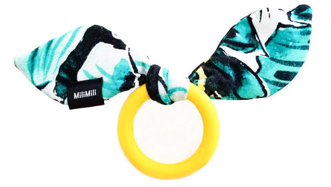 milimili snuggle teether in kauai one print with yellow silicone ring