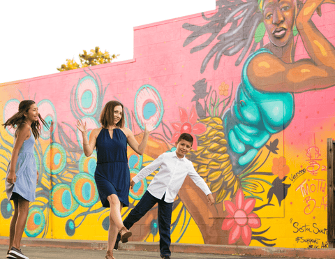yanira guzman and kids against colorful wall for milimili 20 questions series