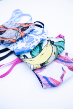 Load image into Gallery viewer, MiliMili cloth face mask summer collection featuring tropical bright prints with bananas, fish, artful swirls, and crane prints
