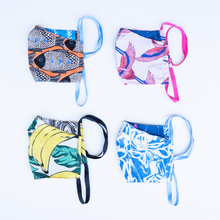 Load image into Gallery viewer, milimili summer collection face mask four-pack, featuring blue modern print, orange fish print, banana print, and pink crane print