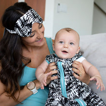 Load image into Gallery viewer, Mom with baby wearing black and white Kilauea sleep sack and matching eye mask for mama