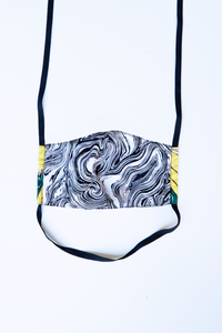 back of milimili banana tropical face mask - featuring black and white marble print