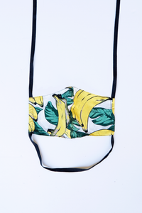 front of milimili banana print face mask, featuring yellow green and black banana print artwork