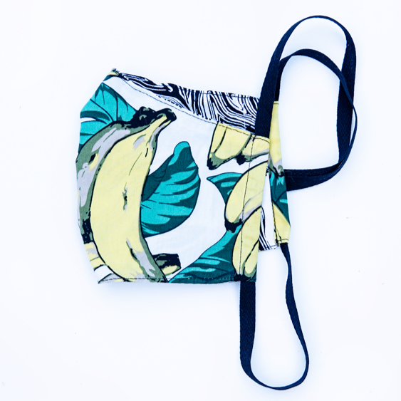banana print tropical fabric face masks, reversible with black and white marbled back.