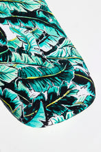 Load image into Gallery viewer, Close up shot of Kauai One (palm print) bassinet sheet featuring green and bright yellow banana leaves