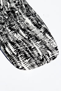 Close up shot of Kilauea (modern abstract black and white) print bassinet sheet