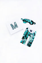 Load image into Gallery viewer, Banana Leaf palm print new parent gift set, including palm print eye mask and palm print tropical sleep sack, shown with gift box