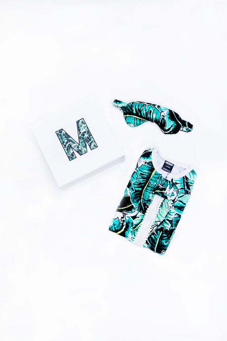 Banana Leaf palm print new parent gift set, including palm print eye mask and palm print tropical sleep sack, shown with gift box