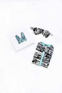 Black and White watercolor print gift set, including eye mask and sleep sack, shown with gift box
