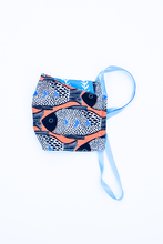 Load image into Gallery viewer, orange blue and black fish print cloth face mask with blue and white striped backing and blue straps.