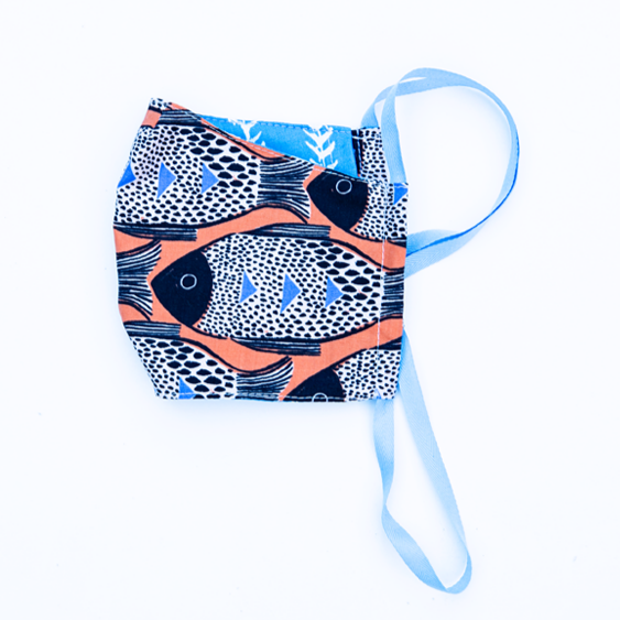 orange blue and black fish print cloth face mask with blue and white striped backing and blue straps.