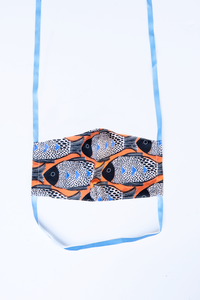 front of milimili fish face mask - featuring orange blue and black fish print