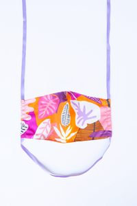 front of milimili guava face mask - featuring purple orange and pink tropical print