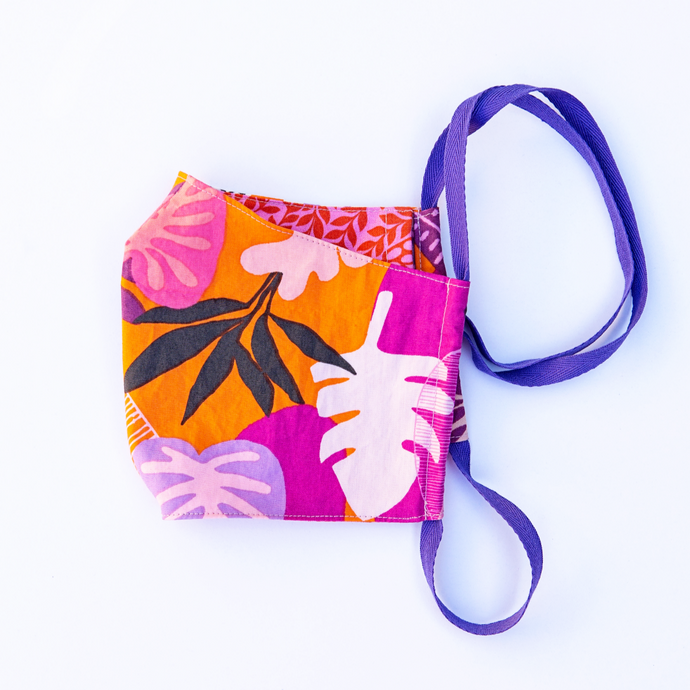MiliMili face mask with Tropical purple orange and pink print front with reversible red and pink floral print back.