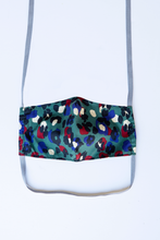 Load image into Gallery viewer, front of milimili leopard face mask - featuring dark teal, blue and red leopard print