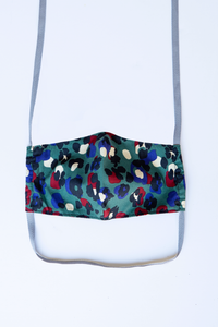 front of milimili leopard face mask - featuring dark teal, blue and red leopard print