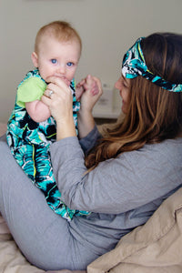 photo of mom wearing palm print eye mask, and baby wearing palm print sleep sack