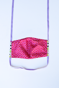 back of milimili monkey print face mask featuring pink and red daisy print