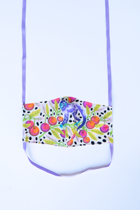 front of milimili monkey print face mask, featuring whimsical purple monkey with red cherries on green branches and black polka dots