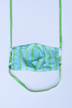 Load image into Gallery viewer, back of milimili monstera face mask - featuring blue and green vine print