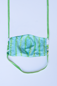 back of milimili monstera face mask - featuring blue and green vine print