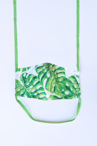 front of milimili monstera palm print face mask - featuring green monstera leaf print