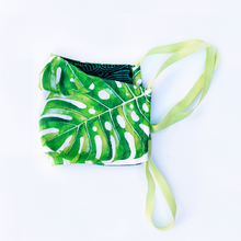 Load image into Gallery viewer, green monstera palm print face mask with reversible blue backing -  milimili
