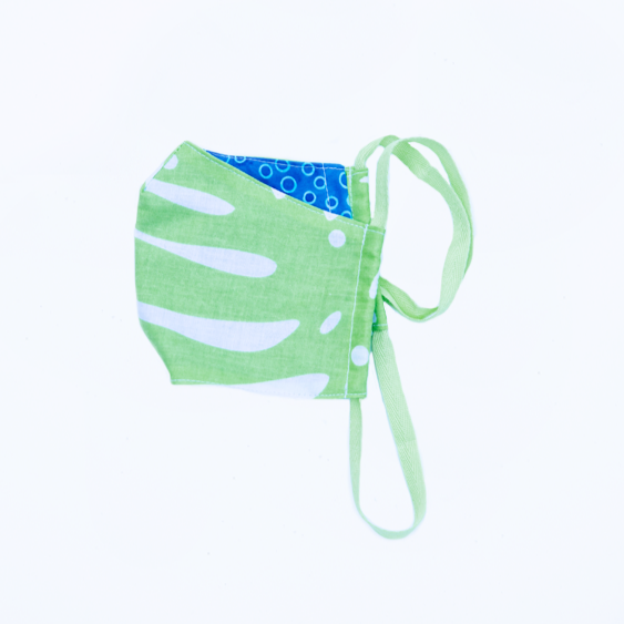 tropical palm leaf kids' face mask in breathable 100% cotton with blue backing