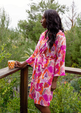 Load image into Gallery viewer, woman wearing tropical lightweight robe while enjoying coffee