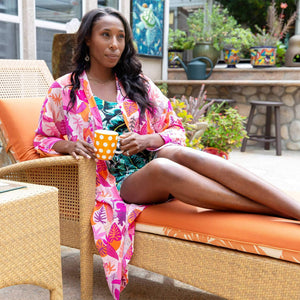 woman wearing tropical lightweight robe while enjoying coffee