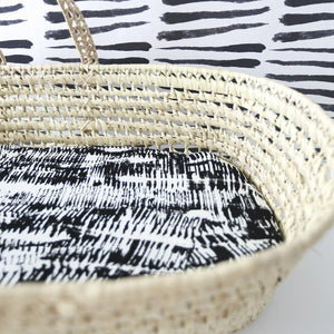 MiliMili modern black and white Bassinet Sheet, Kilauea print, shown in standard moses basket