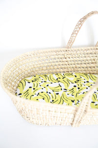 MiliMili Kona Banana  print bassinet sheet, made from the softest bamboo fabric, shown in standard moses basket