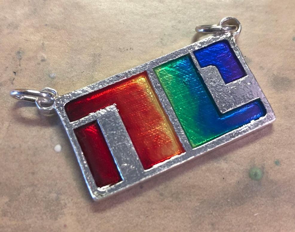 Custom LGBT Bitch Planet Non-Compliant pendant for a customer.