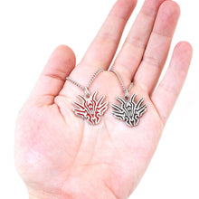 Load image into Gallery viewer, Dustbringers Pendants with Ruby Enamel or Black Antiqued Finishes