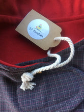 Load image into Gallery viewer, wool blend dog coat; grey check outer with red wool flannel lining, available in 5 sizes to suit all dogs. Flay lay photo showing close up of both fabrics used and the swing tag
