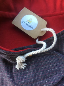 wool blend dog coat; grey check outer with red wool flannel lining, available in 5 sizes to suit all dogs. Flay lay photo showing close up of both fabrics used and the swing tag