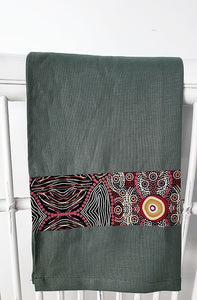 Linen tea towel, indigenous design tea towel, Australian Aboriginal artist, Kokos String by Audrey Martin Napanangka on green linen