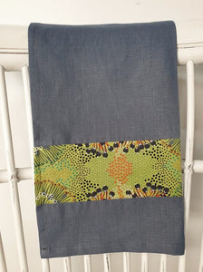 Linen tea towel, indigenous design tea towel, Australian Aboriginal artist, Bush Plum by Polly Wheeler. A splash of bright green print on denim blue linen