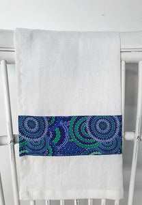 Linen tea towel, indigenous design tea towel, Australian Aboriginal artist, Womens Body Dreamimg by Cindy Wallace. A brilliant splash of blues, greens and teals on white linen