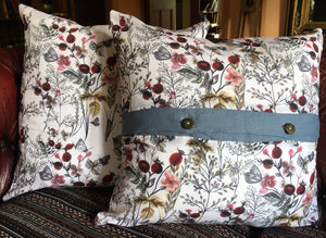 Denim blue linen cushions with a vibrant berry trim and berry print cushions with a contrasting blue linen button trim.