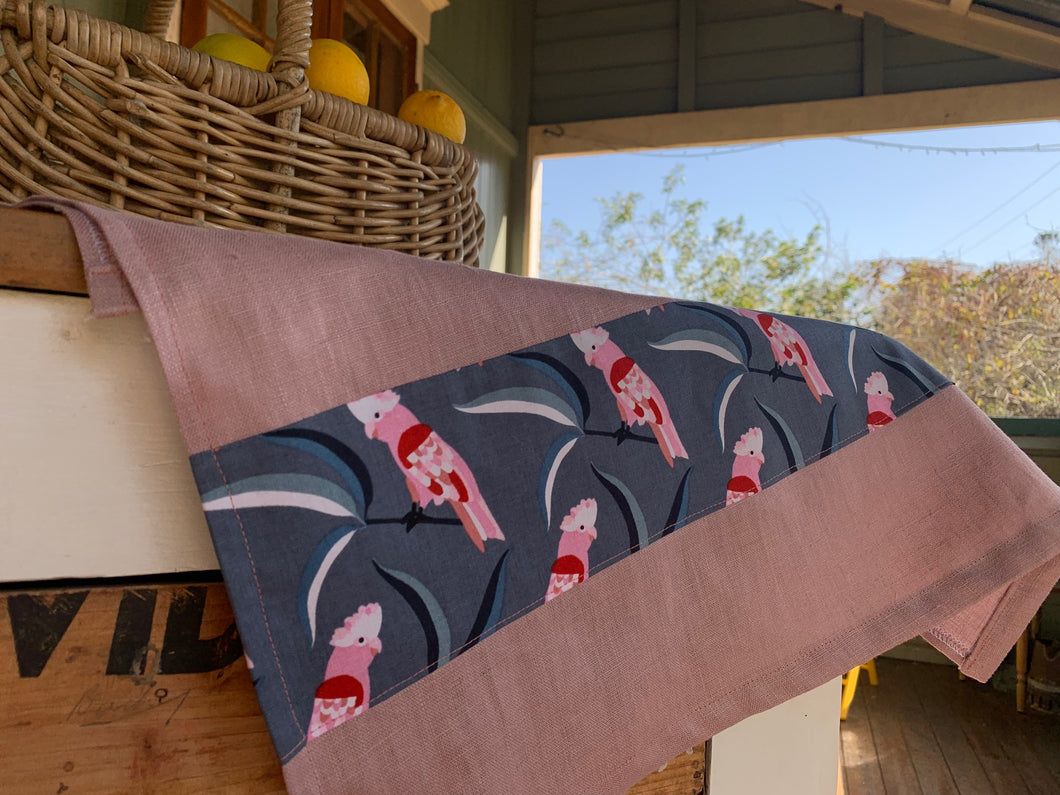 Linen tea towel with Australian homestead influence. Trimmed with galah indigenous or Australian art