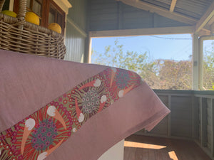 Linen tea towel, indigenous design tea towel, Australian Aboriginal artist, Plum and Bush Banana by Laurel Tanlels on dusty pink linen