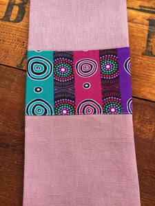 Linen tea towel, indigenous design tea towel, Australian Aboriginal artist, Desert Flowers by Marie E, Ellis on dusty pink linen