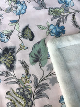 Load image into Gallery viewer, Tropical garden print minky blanket cotton front synthetic lining closeup shows printed cotton and folded corner to reveal minky lining